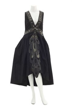 Lanvin black silk taffeta dress embroidered with crystals, silver-lined bugle beads and pearls forming a repetitive abstract pattern of peacock feathers as it overlaps and graduates in size down the front of the skirt, ca. 1926.