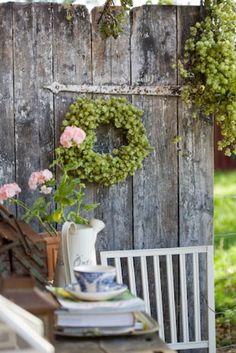 Wreath on old door or fence, nice potting table display