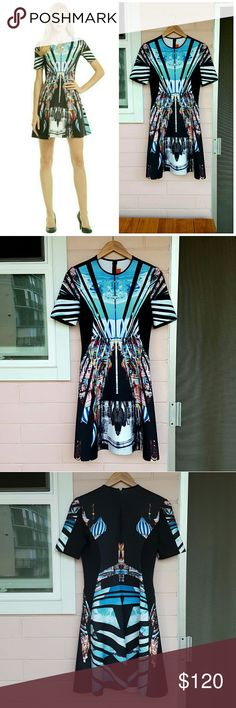 """M CLOVER CANYON FIT & FLARE DRESS -moscow mixup print  -fit & flare a-line dress  -crew neck -short sleeve -zipper & hook closure -approx. 34.5"""" length (size M) -90% polyester 10% spandex -bust: 35-36"""" -waist: 27-28"""" -hip: 37-38"""" -euc - plenty of life left -comes from a smoke-FREE & pet-FREE home Clover Canyon Dresses Mini"""