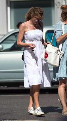 Flirty fun: Jemima, Née Goldsmith, showed off her envy-inducing physique in the chic sundress, with her lithe limbs gym-honed to perfection