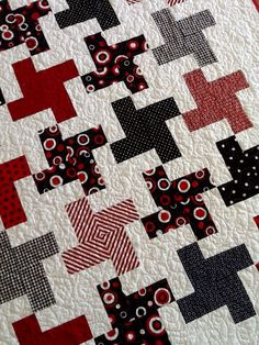 Red white and black baby quilt.  Two by two pattern.  Www.sewingbyjanina.etsy.com