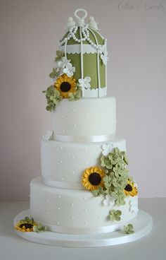 Rustic wedding cake by Cotton and Crumbs, via Flickr. I am not so sure about the bird cage, but other than that I think this is super cute.