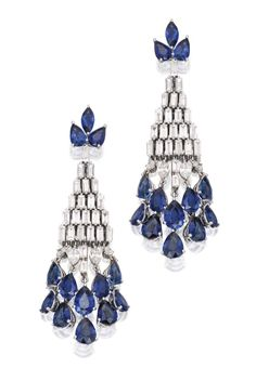 Pair of 18 Karat White Gold, Sapphire and Diamond Earrings. The elongated designs suspending fringes, set with pear and marquise-shaped sapphires, accented by round, baguette and marquise-shaped diamonds. Sotheby's.