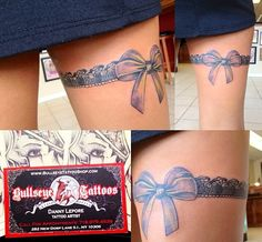 Ribbon thigh tattoo
