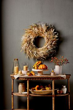 Stalks of oats, millet, and ornamental grasses fill out this wheat wreath, which looks just as lovely hanging above a mantel or sideboard as it does on a front door. #falldecor #fallideas #wreathideas #fallwreath #wreath #bhg