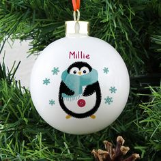 Personalise this penguin bauble - £13.95.