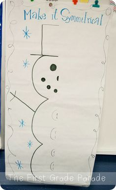 Once we brainstormed things that were symmetrical and did a few little symmetry sorts, we laid out Mr. Half-a-Snowman and all my babies got to help me make him symmetrical.