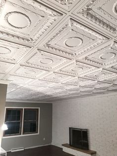 Four Tips for Installing Tin Ceiling Tiles Basement Renovations, Home Remodeling, Basement Ideas, Accent Ceiling, Tin Ceiling Tiles, Basement House, Decorative Mouldings, Chic Bathrooms, Ceiling Medallions