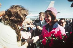 The Kennedys shake hands with a crowd after arriving at Love Field for a campaign stop in Dallas, hours before the president's assassination on Nov. 22, 1963.