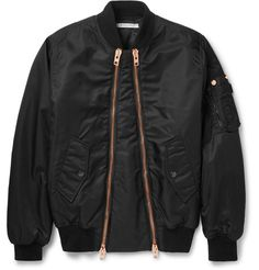 The cool confidence of the bomber jacket has never waned, as evidenced here by Givenchy's black shell version. This piece has a comfortably padded torso and is finished with two asymmetric rose gold zips for a contemporary point of difference. The snap-fastening pockets will keep your personal effects secure, whilst the ribbed trims keep the slim shape looking sharp.