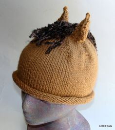 Hand Knitted Horse Hat... ok i need one in haflinger gold with lots and LOTS of white forelock and a very full 'mane' that can be braided LOL! I am having one made for my new helmet wen it comes in. Hey it's cold in Montana... and i cat get a hat UNDER that helmet... so... one onop to match Micha. God help me i'm an old crazy horse mama