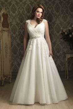 Brides.com: Designer Plus-Size Wedding Dresses We Love. Style W282, tulle wedding dress, price upon request, Allure Bridals See more Allure Bridals wedding dresses.