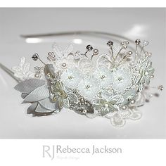 Bridal Tiara / Headpiece 'Dorothy' by Rebecca Jackson, Bespoke       Stunning Swarovski Pearls are hand beaded in to this beautiful piece, Organza, Resin and satin flowers are hand sewn with Ivory pearls, with chiffon trailing leaves and Swarovski Crystals and Pearls are wired in sprays
