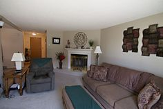 132 Westhills Loop in Gillette, WY has a quaint living room with a cozy fireplace. Can you see yourself relaxing here? Call Team Properties Group for your showing 307.685.8177