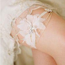 Silk petal and rhinestone garter. thinking of making my very own