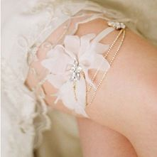 Silk petal and rhinestone swag garter