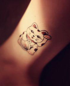 I'd love a maneki neko tattoo, but i would rather do a cat tat for my actual cat