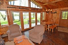 The cozy, 800 square foot interior is bursting with Northwood's charm including knotty log beams and pine walls, log framed doors and windows and distinctive flag stone floor. The living area includes a flat screen TV with Cable TV and DVD player, ceiling fan, phone, sofa sleeper and two comfortable chairs, and a wood burning stone fireplace with beautiful log mantel.  http://4seasonsresort.net/baycottageonlakenamakagon.html