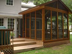 Love the high roof line and natural sain of this screened deck / porch.