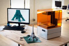"""Form 1 High-Res 3D Printer ($3,300) can print nearly anything you can imagine in exquisite detail. Using high-end stereolithography technology, the Form 1 can construct details as small as 300 microns, and can print objects up to 4.9"""" x 4.9"""" x 6.5"""" in size."""