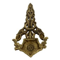 This Diya is a handsome long oil lamp. It is made up of brass and has a very Indian traditional touch to it. It is a small star shaped diya ornamented beautifully with traditional designs, which act as a tall unique handle. It may be used to decorate your Rangoli on Diwali or more significantly as a home decor.