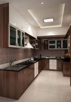 White and dark wooden hues make this modularkitchen special. The sleek cabinets line the walls for storage and the black countertop and offers the cooking space.