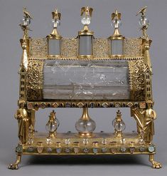 Reliquary:a container or shrine in which sacred relics are kept.  This reliquary is early 19th century with a rock crystal from the years 1175-1200, found in the Meuse Valley )present -day Belgium).  It was sid to once held relics of St. Margaret, St. Philip the Apostle,  St. Catherine and Bishop Valerius.