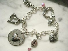 Silver Heart Charm Bracelet with Swarovski Crystals https://www.etsy.com/listing/90043381/silver-heart-charm-bracelet-with?ref=shop_home_active