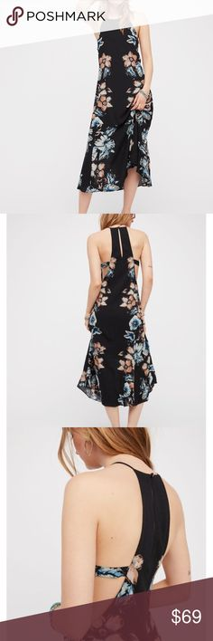 """FREE PEOPLE Midi Dress NWT! In Black Easy, flowy midi dress featuring a shift silhouette with a lovely femme floral print and cutout side details.  *Lined *Back keyhole cutout *100% Rayon *Machine Wash Cold *Measurements for size Small:  -Bust: 36.5""""  -Length (From Top Of Bodice): 45""""   -Model Height: 70.5""""   ❌NO TRADES  I❤️Bundles ❤️REASONABLE OFFERS ONLY PLEASE❤️ Free People Dresses Midi"""