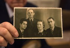 Auschwitz survivorLeon Schwarzbaum (pictured, holding a picture of himself (left) next to his uncle and parents who all died at the death camp) said it would be very unsettling to come face to face with the former SS guard in court on Thursday