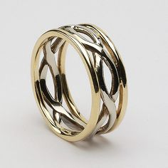 The Aibreann Infinity Band is an ideal Celtic wedding ring. It features the classic endless Celtic knot in white gold, with the choice of an elegant 2mm trim on each side either in contrasting yellow gold, - See more at: http://www.celtic-weddingrings.com/Celtic-Wedding-Rings/Aibreann-White-Gold-with-Trim-P11.html#sthash.d223ZXvR.dpuf