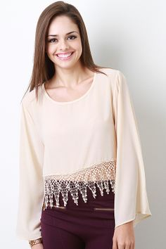 Look chic effortlessly in this Elizabeth Blessing Top. This lightweight chiffon top features a round neckline, keyhole at nape, long bell sleeves, crop hemline accent with crochet lace fringe
