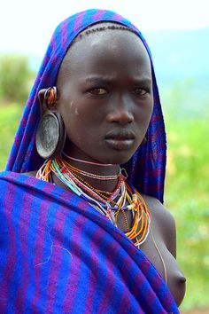 A Surma woman wears a wary expression.
