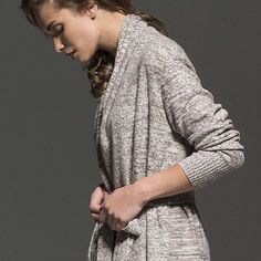 Exceptionally warm without the heavy feel, this gorgeous melange coat with shawl collar is your perfect choice for cold days. Oozing a subtle boho vibe, this impeccably soft coat spun from high quality cashmere is finished with fringes at the hem and comes with a belt for waist definition. Great with monochrome separates.  Cashmere Maxi Coat with Fringed Trim Also see #cardigan #sweater #tunics #dresses #robes