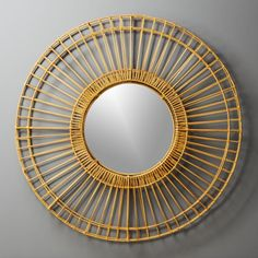 "Shop Ferris Natural Round Wall Mirror 41. 5"".   Double-layered rattan forms open framework reminiscent of a ferris wheel.  Surrounds modern glass mirror with laid-back, natural style."