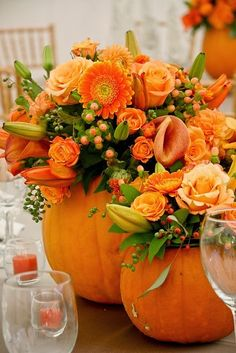 Orange Flower Table Setting What a fabulous way to use your pumpkins!