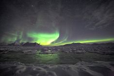 Northern Lights over the frozen Arctic fjord by Witek Kaszkin on Free Travel, Travel List, Svalbard Norway, Longyearbyen, Northen Lights, Arctic Circle, Places To Visit, City, World