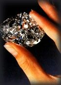 The Centenary Diamond -  found by De Beers in 1986. Cut from the rough a  273.85 carat D color is the largest faceted diamond in the world.  The rarest of them all.
