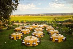 yellow tablecloths and brown chairs