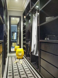 Chic glossy black walk-in closet design with yellow stool, black geometric runner, black beveled floor mirror and black built-ins. Armoire Dressing, Dressing Room Closet, Dressing Room Design, Dressing Rooms, Dressing Area, Walking Closet, Walk In Closet Design, Closet Designs, Long Narrow Closet