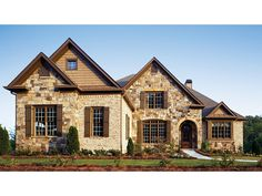 Floor Plan AFLFPW22134 is a beautiful 2776 square foot + French Country  home design with 2 Garage Bays