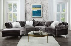 """Acme 57355 4 pc Waldorf park ninagold gray velvet like fabric curved half circle tufted sectional sofa with chaise. This set features tufted backs and nail head trim accents, clear acrylic legs and throw pillows. Sectional measures 139"""" x 74"""" D x 32"""" H. Some assembly required."""