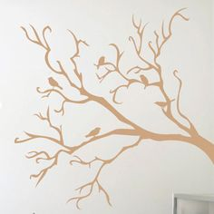 Wall decal with a tree branch and perched bird silhouette.  Product: Wall decalConstruction Material: Vinyl...