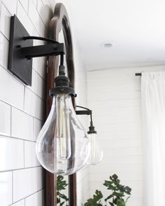 Industrial bathroom sconce