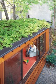 A green roof helps make up for lost garden space and creates a beautiful leafy view from the second and third floors. In summer, when the sliding doors are left wide open, indoor and outdoor spaces blend together. #greenroofs
