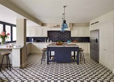 The cabinetry in this kitchen - from Martin Moore's English collection - was deliberately kept quiet and restrained, echoing the period origins of the house and leaving room for vibrant, contemporary colours and patterns to take centre stage. Bespoke Kitchens, Luxury Kitchens, Martin Moore Kitchens, Suffolk House, Victorian Terrace House, Urban Kitchen, Splashback Tiles, Steel Columns, English Kitchens