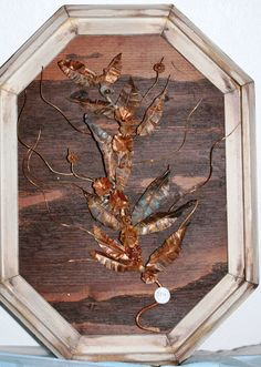 Hand made wood frame with hand hammered copper flowers.