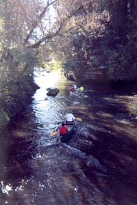 A canoe traveling the Kickapoo River - shoreline camping in Wisconsin - quite a few options