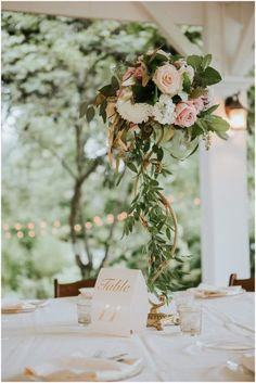 Gorgeous centerpieces by Cedarwood Weddings. Blush white green and gold. See more of this southern boho bride in this blog post! / Sarah Sidwell Photography offers wedding coverage in Nashville, Franklin, Brentwood, and surrounding areas in Tennessee. And is available for destination weddings.