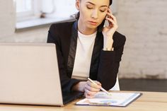 Business woman at office talking on phone about work